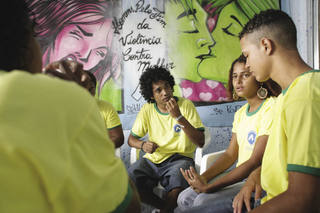 Rio slums where bodies lie in blood and teen gangs with guns rule the day